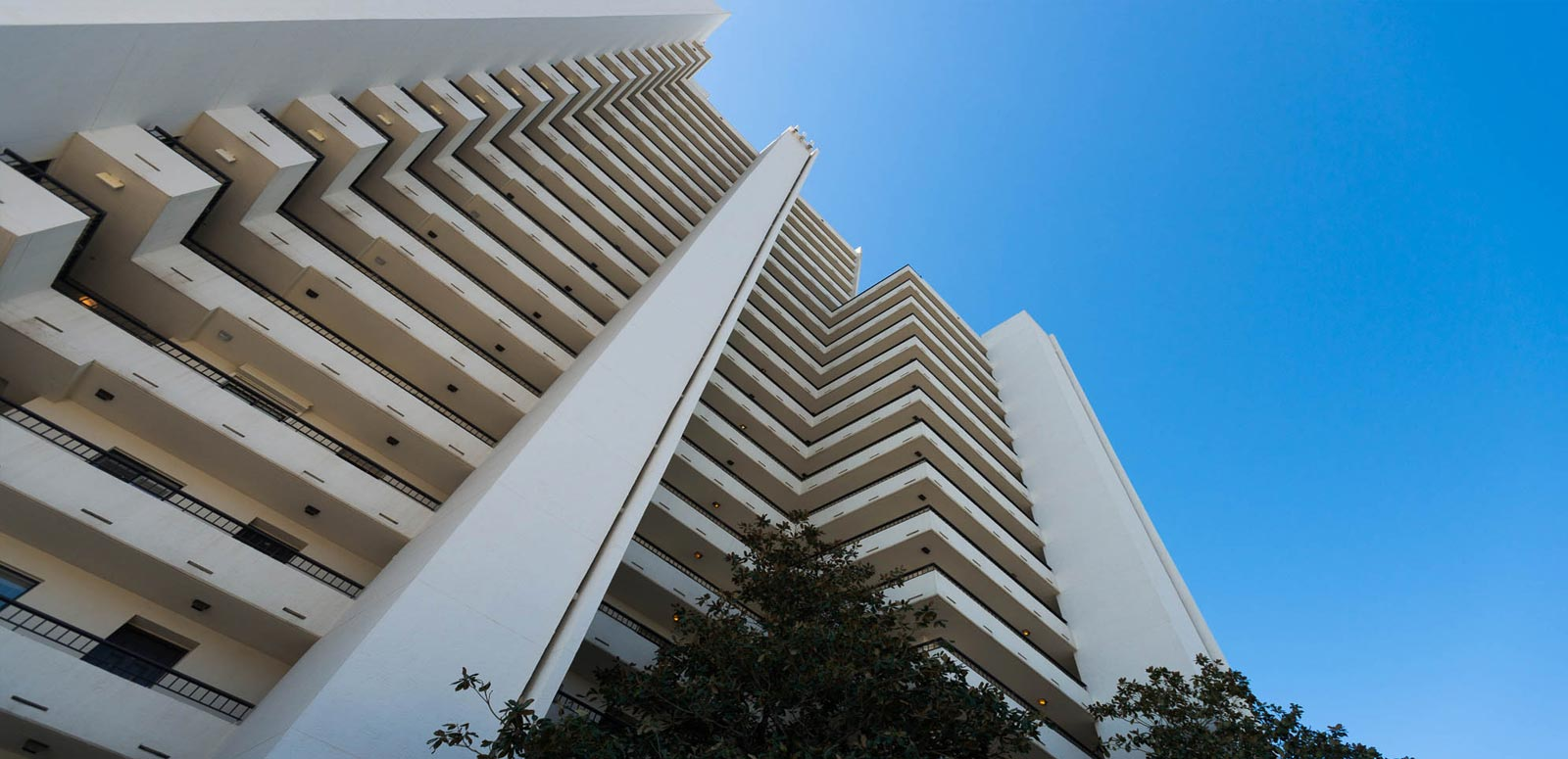 Exterior view of One Seagrove Place condominiums with beach view balconies